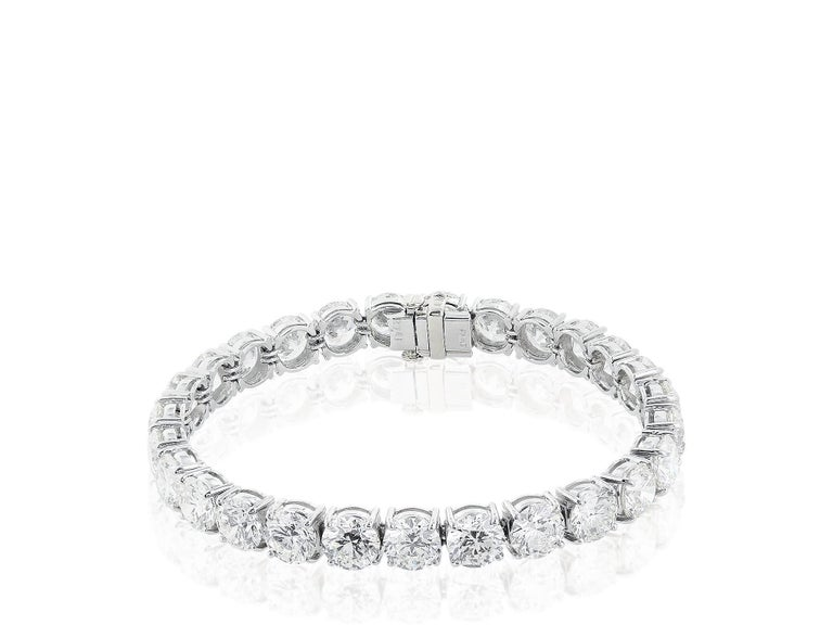 14 karat white gold round brilliant cut diamond flexible tennis bracelet. Consisting of 40 round brilliant ideal cut diamonds having a total approximate weight of 9.52 carats with a color and clarity grade of approximately G-H/VS2.