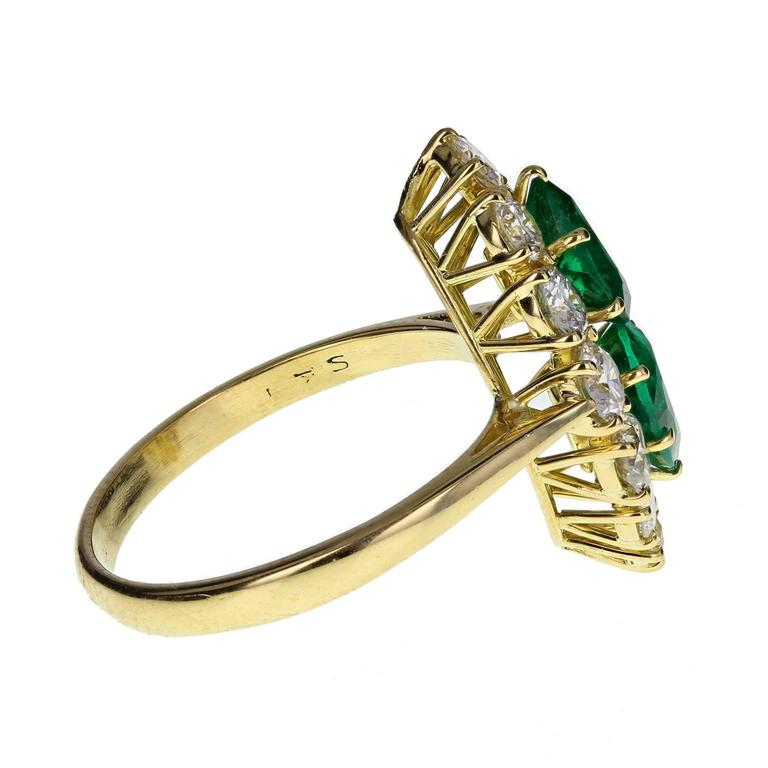 Modern Fine Quality Marquise Shaped Emerald Diamond Gold Cluster Ring For Sale