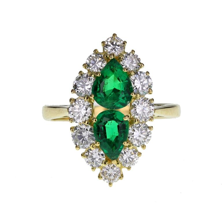 Fine Quality Marquise Shaped Emerald Diamond Gold Cluster Ring For Sale