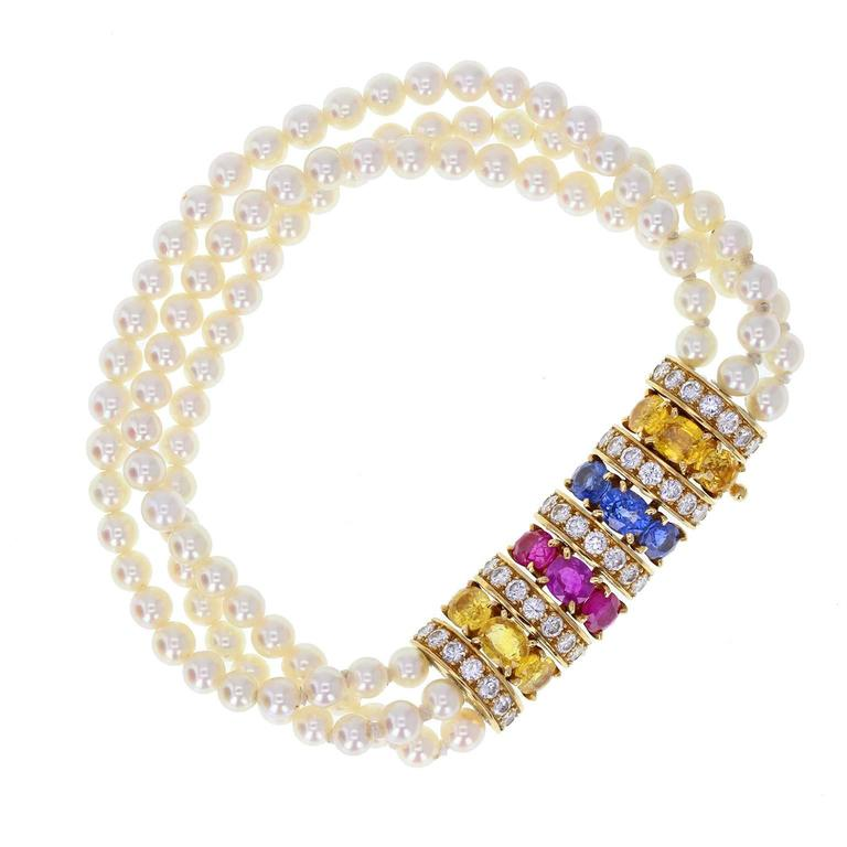 A stunning vintage parure by Van Cleef & Arpels Paris, comprising a bracelet, necklace and pair of earrings. Necklace and bracelet in the form of three rows of cultured, saltwater pearls, gently graduating from 4 to 4.5mm, terminating at a