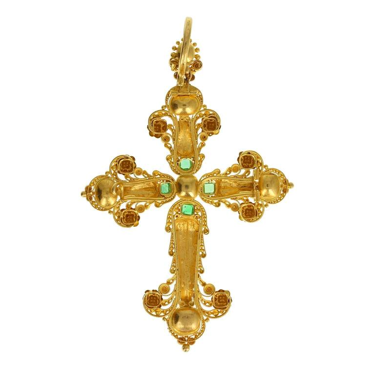 This fine and impressive Georgian cross is in exceptional condition. Each arm of the cross is formed in 18 carat gold cannetille work, with applied rosettes and acanthus leaf motifs. A central cushion-cut pink topaz, surrounded by four emerald-cut