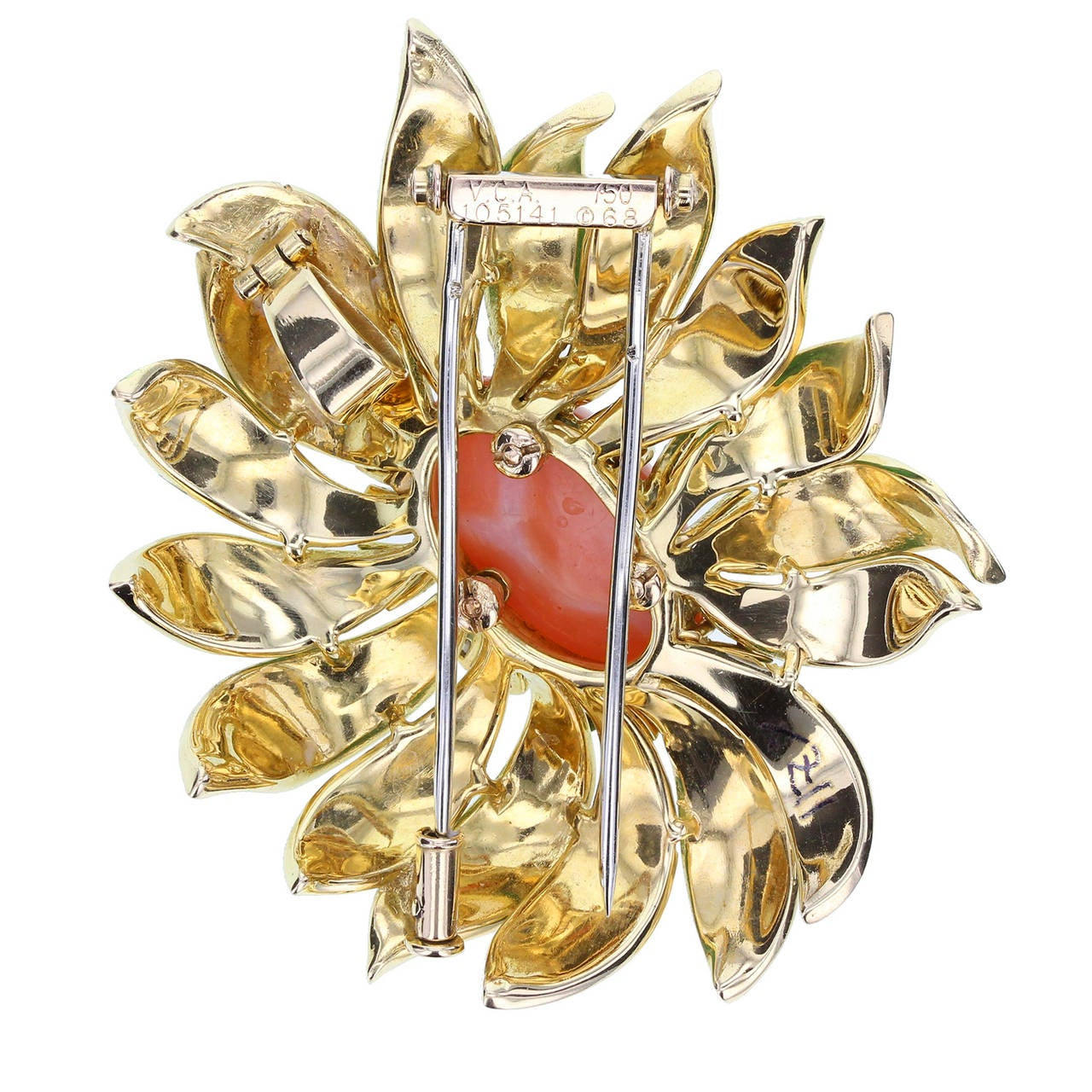 Central pink coral cabochon surrounded by gold foliate decoration, adorned with diamonds and green enamel. Brooch fastening to rear with hinged bale so may be worn as either a brooch or pendant necklace. Signed VCA