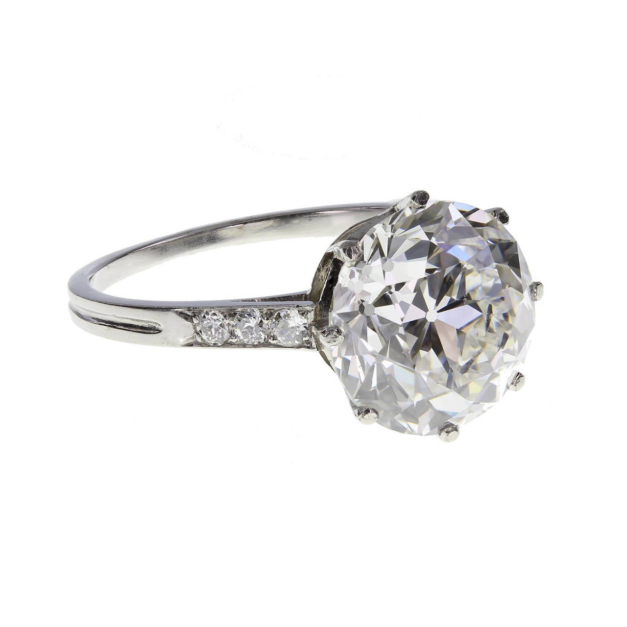 A 3.91 carat brilliant-cut diamond in a classic eight-claw setting with diamond set shoulders. All platinum. Signed Boucheron Paris and accompanied by an HRD certificate stating that the diamond is 3.91 carats, E colour and SI1 clarity. An exquisite
