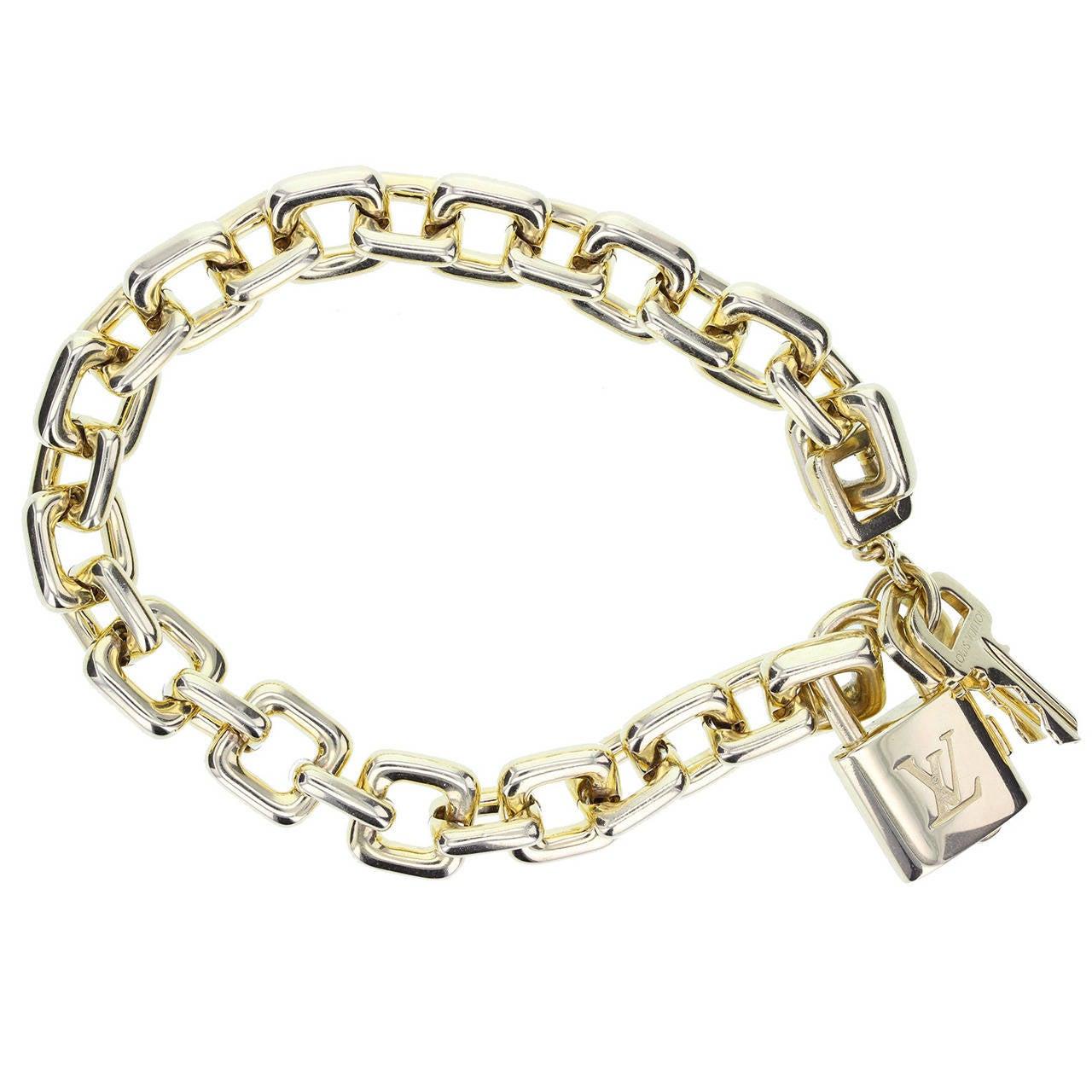 louis vuitton heavy gold padlock and key bracelet at