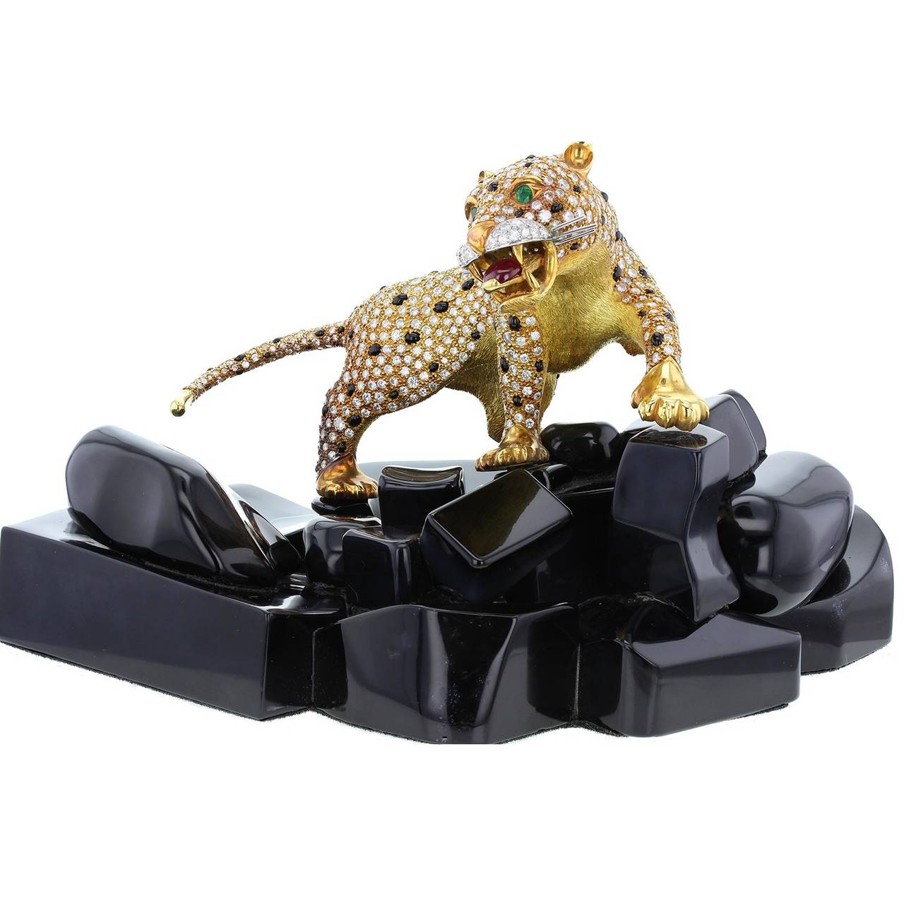 A rare and quality work of art fashioned from 18 carat gold, diamonds, rubies, emeralds and onyx. Created by a highly skilled jeweller it features a prowling panther with a polished onyx and brilliant-cut diamond set body, with emeralds as eyes and
