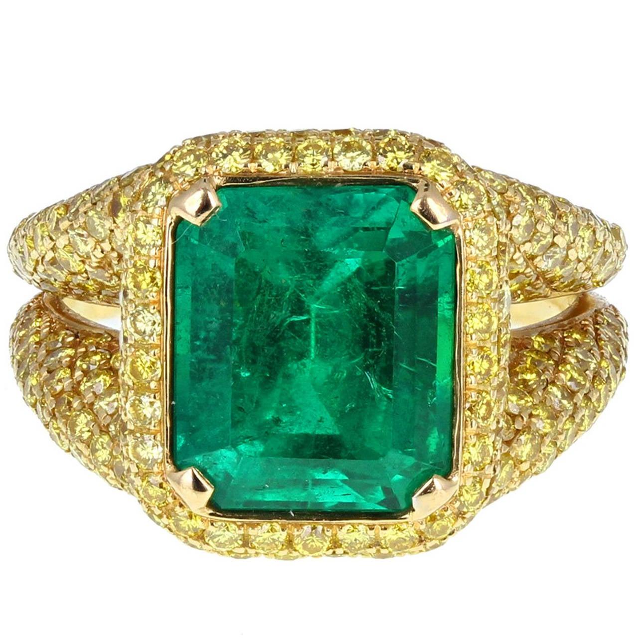 Modern 5.50 Carat Colombian Emerald Yellow Diamond Ring