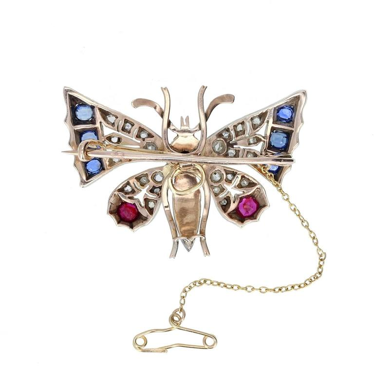 This fine quality, mid-Victorian brooch is crafted beautifully. The body adorned with grey pearls and two ruby eyes, with dramatic, pierced wings mounted with rose-cut diamonds, blue sapphires and blood-red rubies. Rampantly Victorian in style and