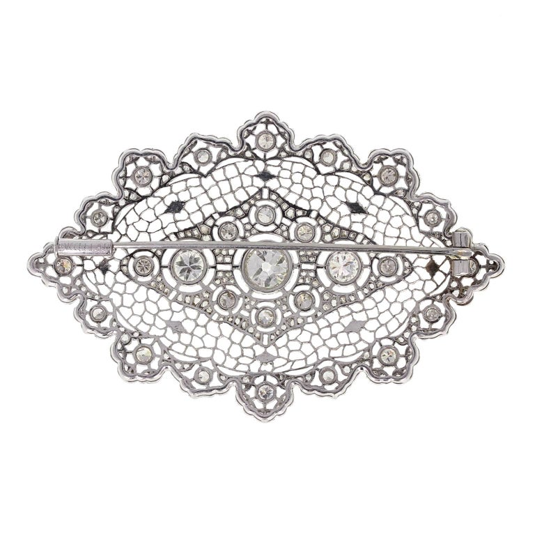 An exquisite quality, honeycomb lace brooch by Buccellati. The trademark honeycomb styling instantly recognisable as the Italian high jeweller. Set with brilliant-cut diamonds, accented with rose-cut diamonds and a floral/ribbon detailing. The