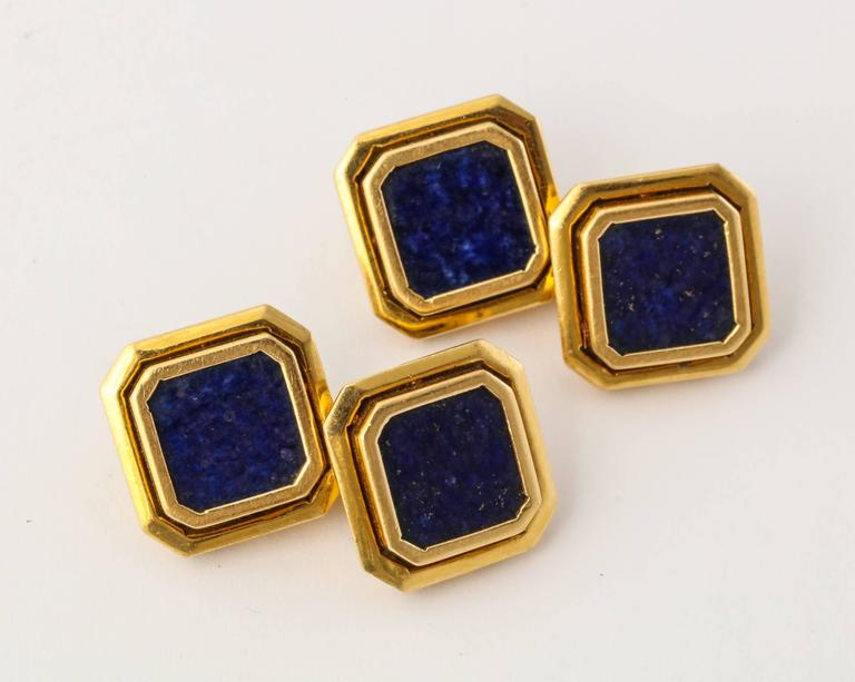 Elegant and masculine 18K gold cufflinks as a frame within a frame, set with flat slabs of rich dark blue lapis lazuli, flecked in gold like a starry night sky. Italian gold marks. 1/2 inch square.