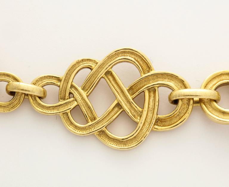 Stunning! This wide and weighty 1960s chain necklace from Buccellati Italy of hand finished 18K gold knots was created to comfortably hang long with enough weight to keep from shifting.  Buccellati's own version of the classic Celtic knot. Links are