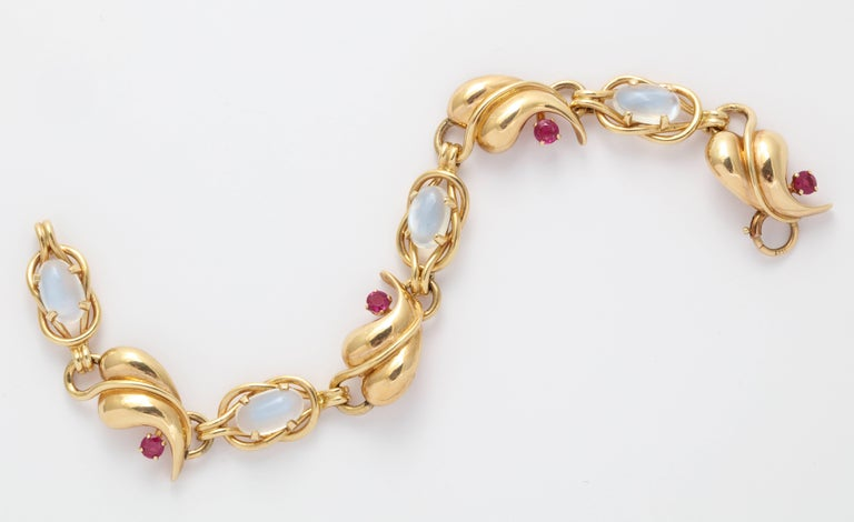 A very pretty 1940s 14K gold link bracelet set with glowing cabochon moonstones and natural rubies. 17.4 grams. 1/2 inch wide x 7 1/4 inches long.
