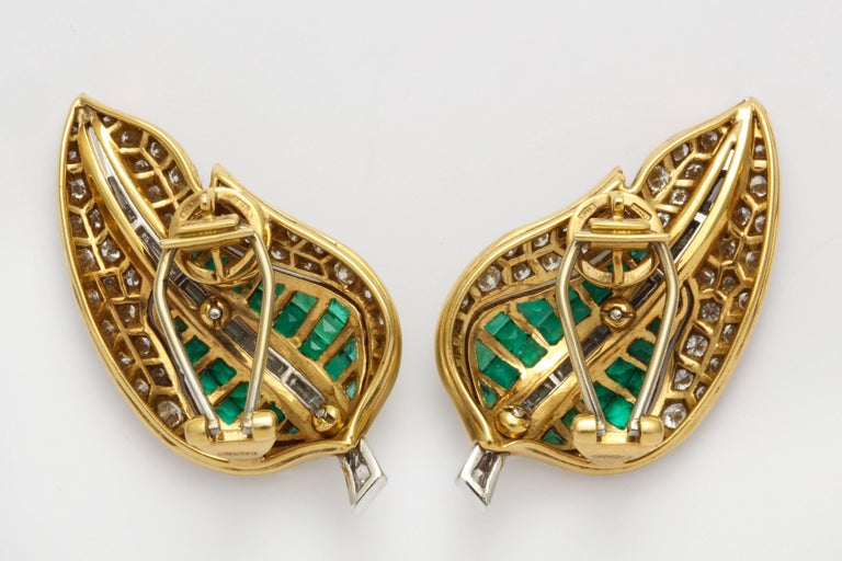 Stylish Fred Leighten custom ordered ear clips of 18K gold formed as curving leaves set with round diamonds and square cut emeralds centered by a row of baguette diamonds. 18K Gold mark. 1 in. x 1 3/4 in.
