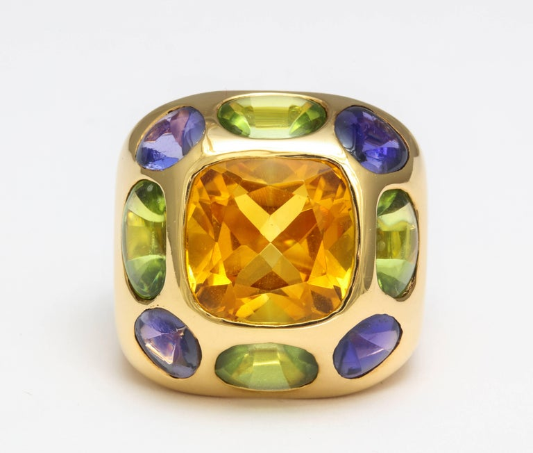 1990s Chanel ring in 18K gold set with citrine, peridot and amethyst. Registration numbers, gold mark, Chanel mark. Fits 6 1/2 finger, top measures 7/8 x 7/8 inches, 19.4 grams.