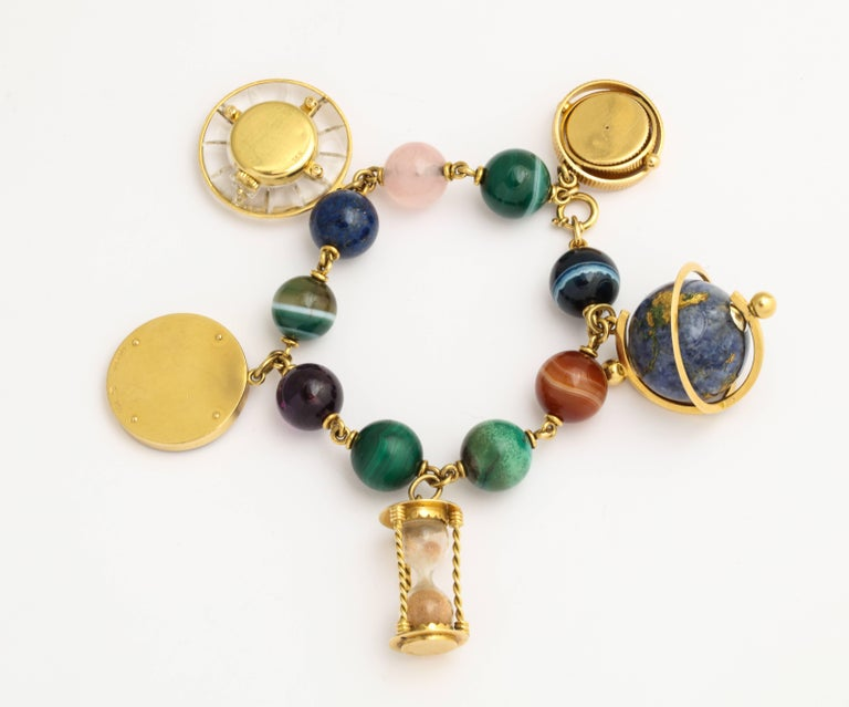 Gubelin Time Themed Gold and Hard Stone Charm Bracelet Watch For Sale 5