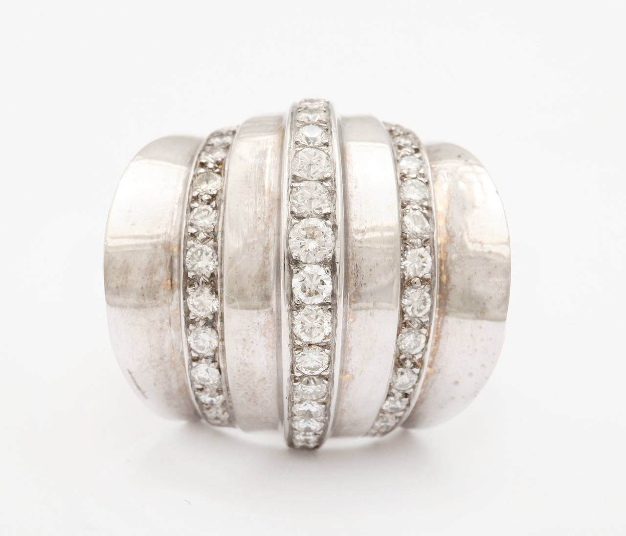 A very bold and stylish Retro ring with strong art deco lines, fashioned of 14K gold and set with simple accent rows of diamonds. Unmarked. Fits a size 8 finger and easily sized up or down.