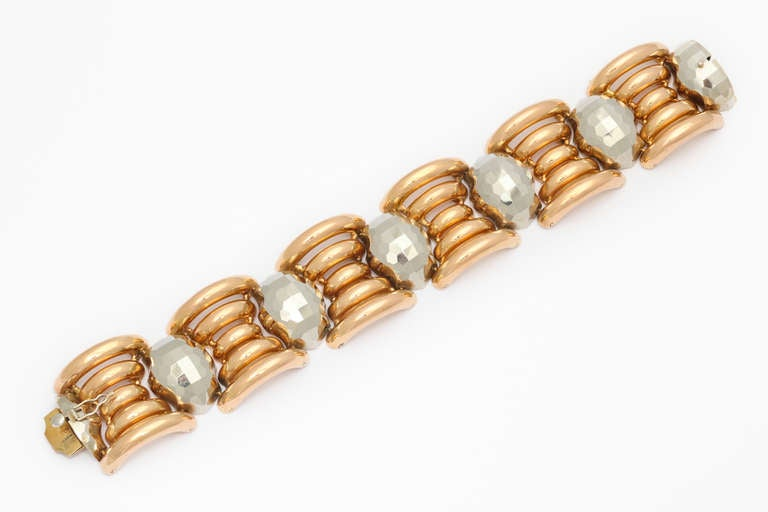 A spectacular and unusual 1940s Italian Retro bracelet crafted in tubular links of 18K rose gold, flanking grey gold links formed to imitate large faceted stones. 51.8 grams. 1 1/4 inches x 7 3/4 inches. Marked: 750, and unidentified makers marks.