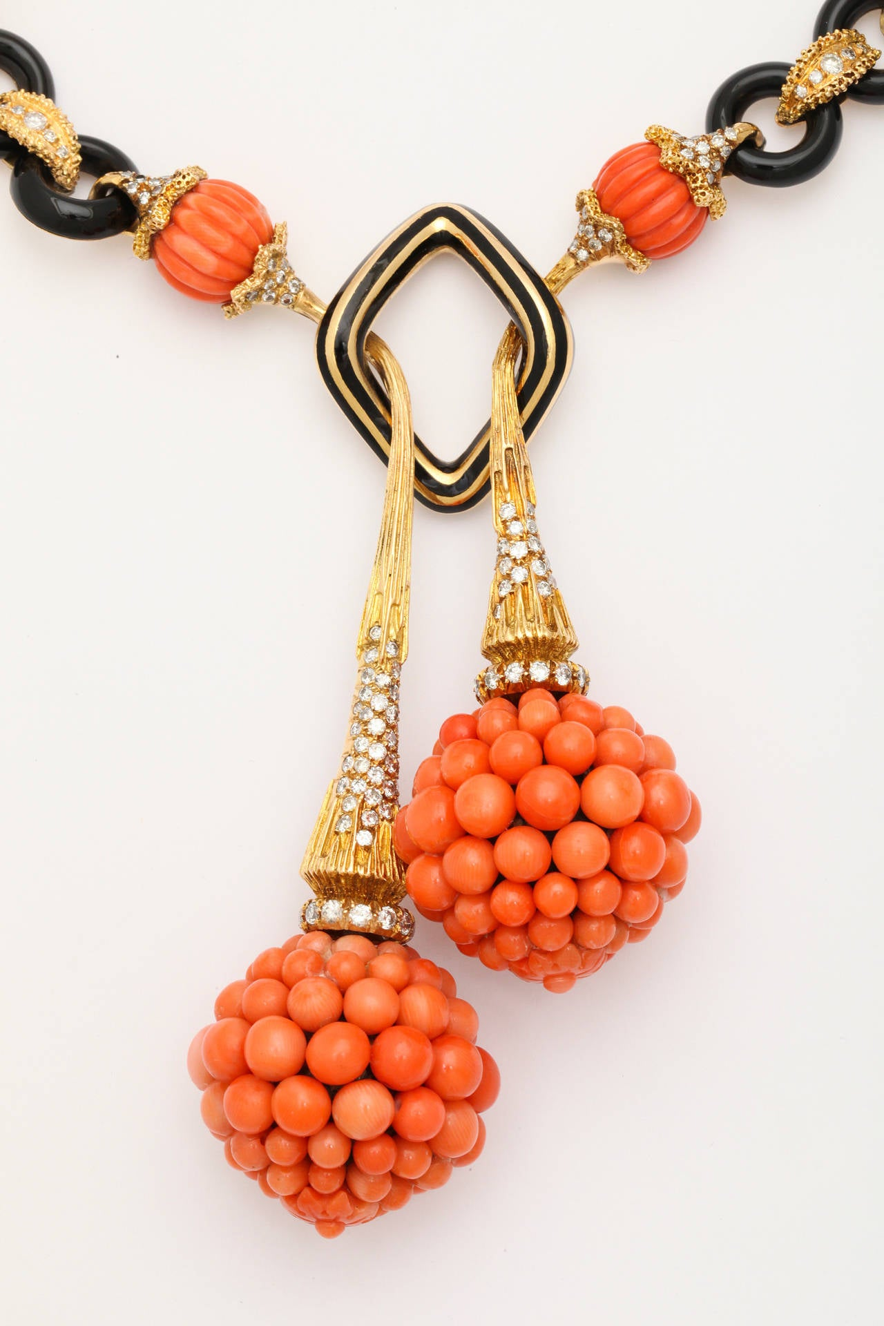 Coral jewelry is extremely fragile as it is made of the calcified remains of microscopic animals. It can be polished to a beautiful shine and is often set in a bezel in order to protect the edges of the piece.