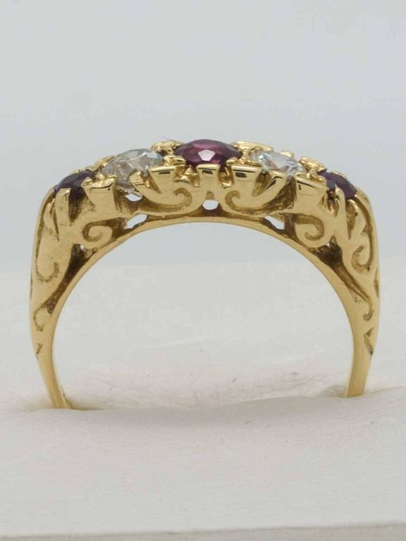 Victorian Era 18K YG ruby and diamond band circa 1900. Very pretty design, classic 5 stone ring with 3 untested old cut rubies alternating with 2 old european cut diamonds. Center ruby is 0.25 approximate carat, 2 side rubies are 0.10 approximate