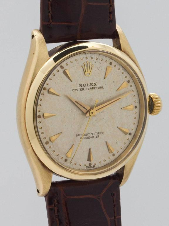 Rolex Yellow Gold Oyster Perpetual Wristwatch Ref 6564 circa 1960 In Excellent Condition For Sale In West Hollywood, CA