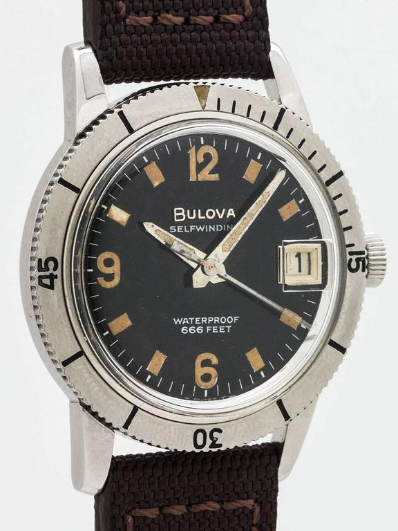 Bulova Diver's model ref 386-1 circa 1964. Featuring a 34mm stainless steel diameter case with rotating elapsed time bezel and embossed screw down case back. Original glossy black dial with warmly patina'd luminous indexes and hands. Very popular