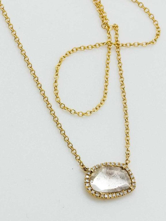 Modern 14k yellow gold diamond slice surrounded by tiny micro pave set diamonds. Free from diamond weighs 0.40ct and tiny diamond melee totals .07ct. Can be worn 16-18″ long. Very pretty and versatile feminine design that compliments antique and