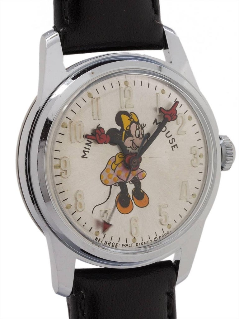 Vintage medium size Helbros 17 jewel manual wind Minnie Mouse watch circa 1970's. Featuring 31mm diameter chromium plated case with steel screw down back, with acrylic crystal, and with excellent condition original dial with polychrome depiction