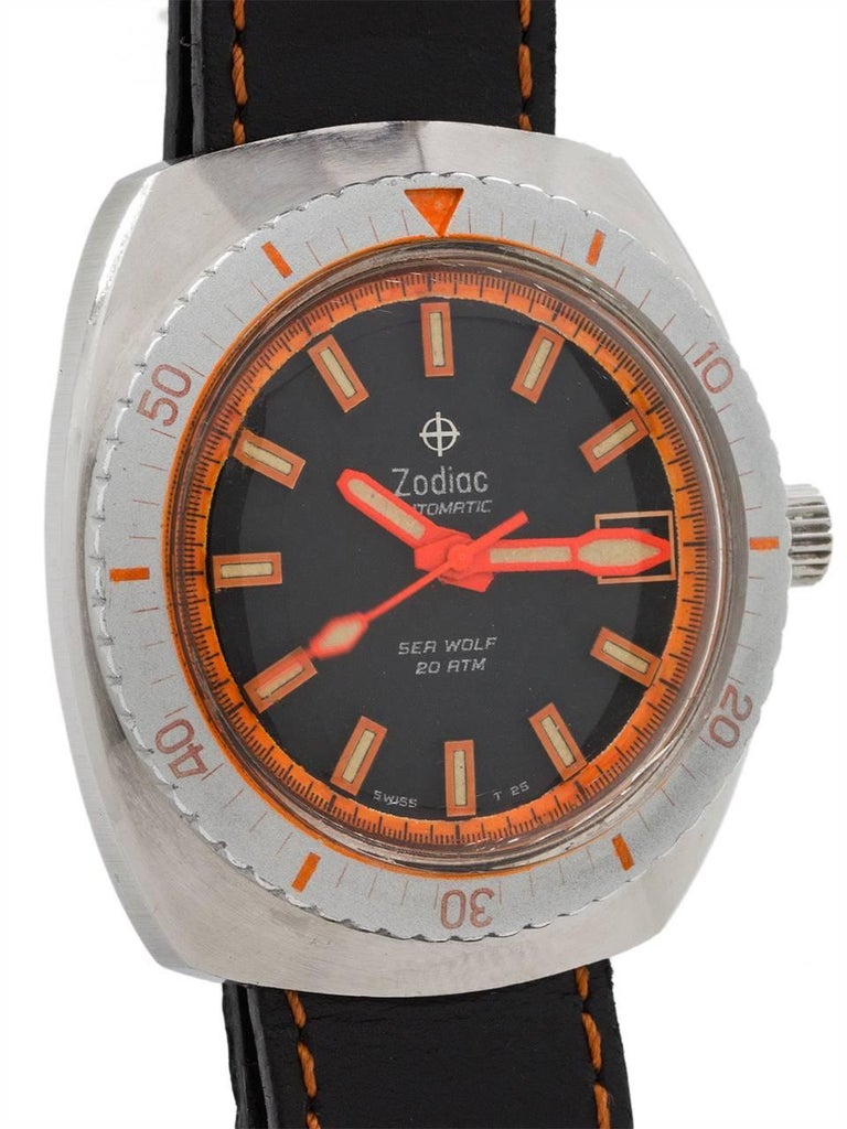 An extremely nice condition example vintage Zodiac Sea Wolf, classic diver's model circa 1970's. Featuring large 43.5mm tonneau shaped case with screw down back and correct Zodiac cross hair screw crown. With silver and orange elapsed time bezel,