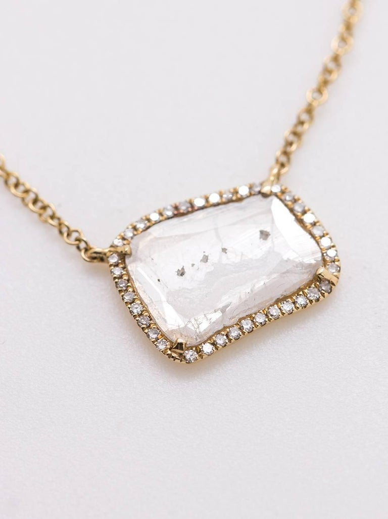 This modern, minimalist 14k yellow gold diamond slice necklace features an asymmetrical, stationary diamond-slice pendant surrounded by a bright row of super sparkly pave-set single cut white diamonds, approximately 0.66ct total weight. The dainty