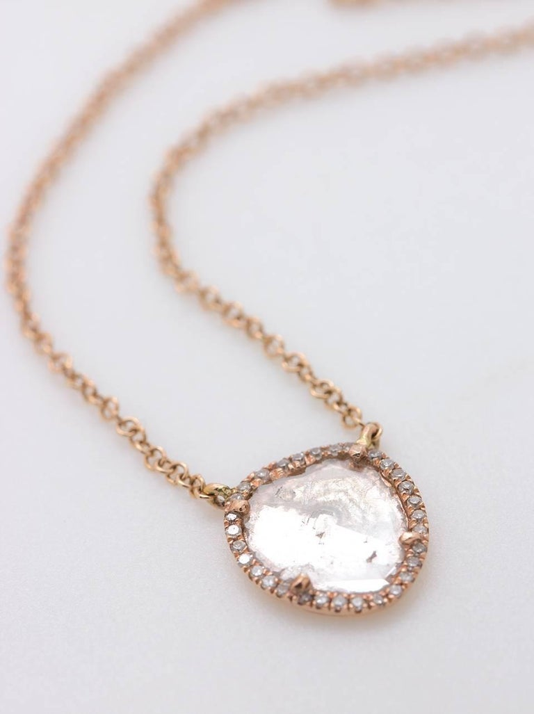 This modern, minimalist 14k pink gold diamond slice necklace features an asymmetrical, stationary diamond-slice pendant surrounded by a bright row of super sparkly pave-set single cut white diamonds, approximately 0.08ct total weight. The dainty