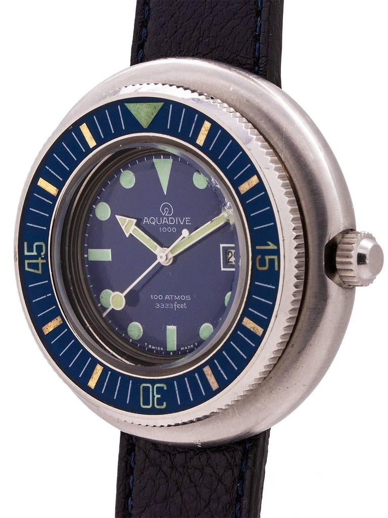 """Vintage circa late 1960's Swiss Aquadive. Featuring a large and thick 50mm """"saucer shaped"""" stainless steel case with a wide stepped up, blue bakelite elapsed time bezel. Featuring a mineral glass crystal, and great condition dark blue original dial"""
