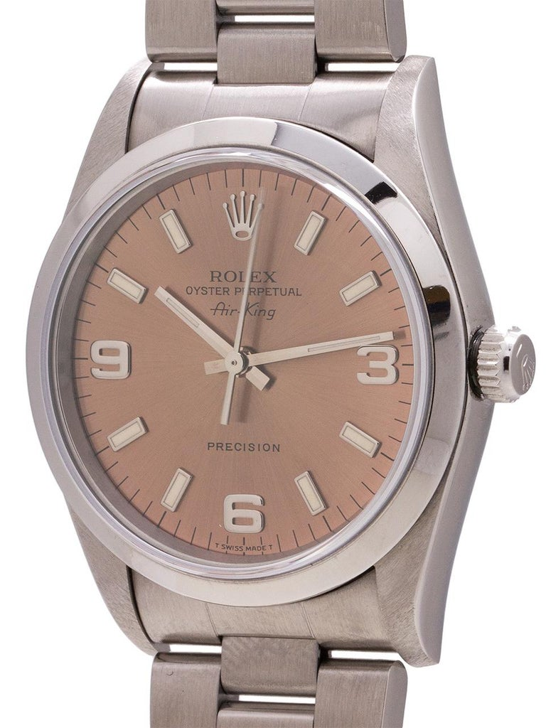 Rolex stainless steel Airking ref 14000 T5 serial # circa 1996. Featuring a 34mm diameter case with smooth bezel, sapphire crystal, and original rose dial with popular Explorer style 3 6 9 configuration. Powered by self winding calibre 3130