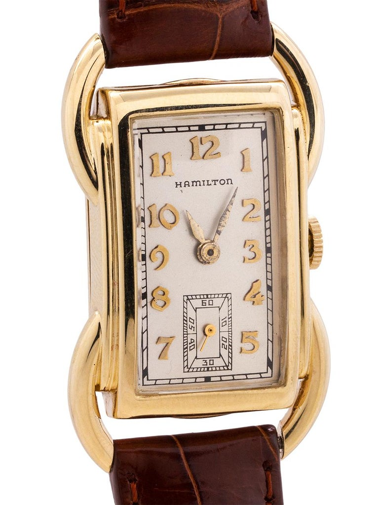 "Vintage man's Hamilton 14K YG ""Bentley"" model. The Bentley is one of the most distinctive case designs of the early Hamilton models with prominent curved tubes on each side of the case and extending beyond the case to form the lugs. The watch"