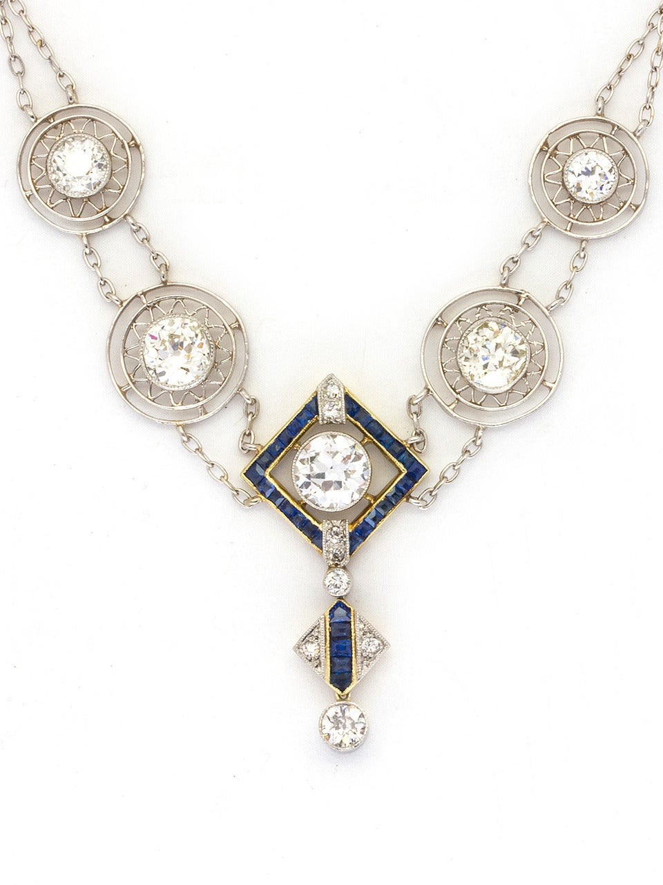 Absolutely stunning Art Deco Diamond necklace made of platinum over 18K yellow gold with over 3.50cts old European cut bezel set diamonds,VS1-VS2/G-H, in sunburst pattern plaques. Center diamond and drop are accented with calibrated French cut