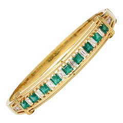 Vintage 18 Karat Yellow Gold Emerald and Diamond Bangle Bracelet, circa 1940s