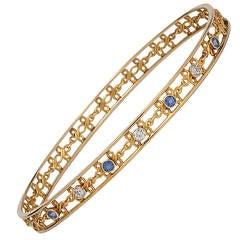 Vintage Diamond and Sapphire 14 Karat Yellow Gold Bangle Bracelet, circa 1930s