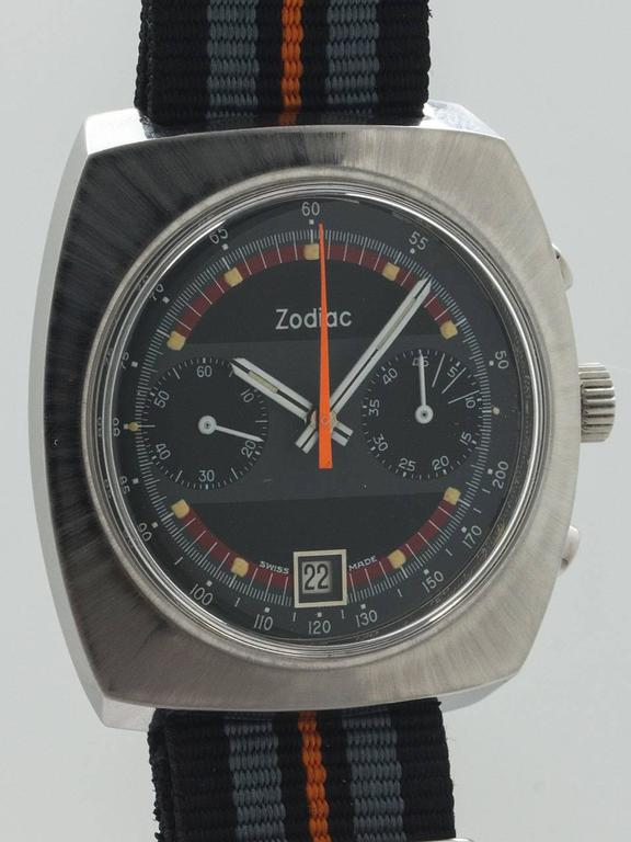 Zodiac Stainless Steel Chronograph Wristwatch circa 1970s. Robust 40 x 44mm cushion shaped stainless steel ref no. 842.888 signed Zodiac case. With beautiful condition original gray, black, and orange detail dial with applied silver indexes and
