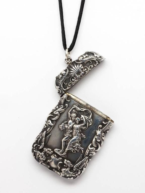 Fantastic, sterling silver Art Nouveau match safe pendant. In a highly intricate repousse design of God and Goddess, griffins, shells and sea serpents. Gorgeous hand engraved monogram on opposite side G E W. This beautifully executed antique match