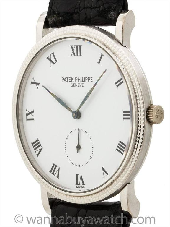 Patek Philippe 18K White Gold Calatrava ref 3919 circa 1990's. Classic hobnail bezel 33mm diameter case model with snap on back. White enamel dial with Roman indexes and tapered blued steel leaf style hands. Powered by 18 jewel manual wind movement