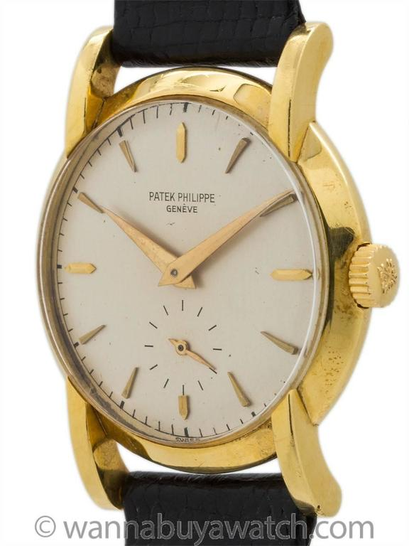 Vintage man's Patek Philippe 18K YG ref# 2429 circa 1955-1959. Very pleasing sculpted design medium size 32.5mm diameter case with nicely formed lugs extending from the edge of the dial. Featuring an exceptional condition original matte silver dial