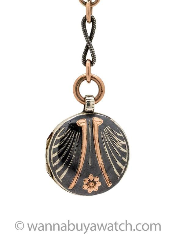 Striking Niello sterling silver and rose gold filled locket on 17 inch chain, with gorgeous contrasting etched, swirled links. Large, etched spring ring bail clasp on detachable locket pendant, which is 3 inches long. The locket itself is adorned