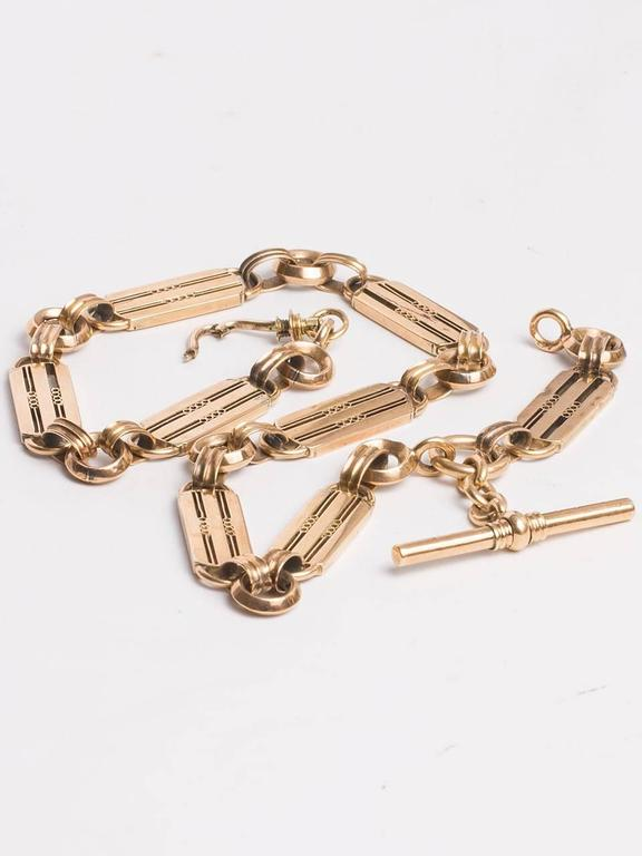 Gorgeous, supple 9K yellow gold pocketwatch chain necklace, 16.25 inch length,  widest links measure 10mm wide.  Beveled rounded smaller links set between 1.25 inch long rounded rectangular stations, with straight line detailing.  Fantastic