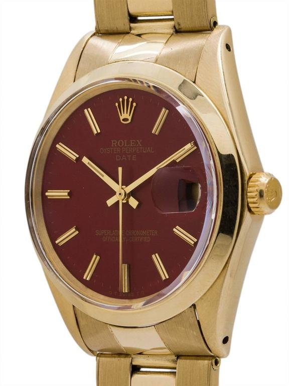 """Rolex 14K YG Man's Oyster Perpetual Date ref 1503 serial#2.08 million circa 1969.  Featuring a 34mm diameter  case with 14K YG smooth bezel with acrylic crystal and beautiful """"brick red"""" color dial with applied gold indexes and gilt hands. Powered"""