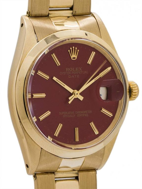 Modern Rolex Yellow Gold Oyster Perpetual Date Brick Red Wristwatch circa 1969 For Sale