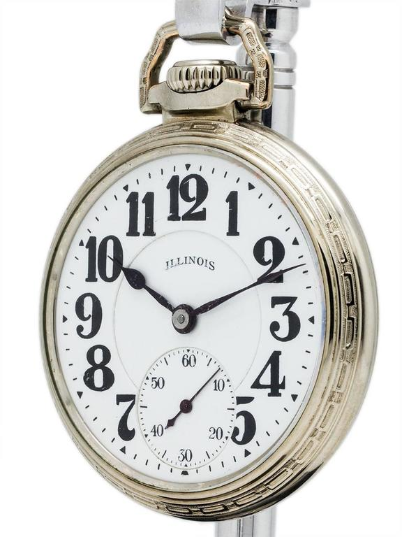 Beautiful example Illinois 16-S Bunn Special 60 hour base metal pocket watch, circa 1929. Gorgeous double sunk white enamel dial with bold Arabic numeral markers, subsidiary seconds at 6 o'clock and blued steel spade hands. Excellent condition,
