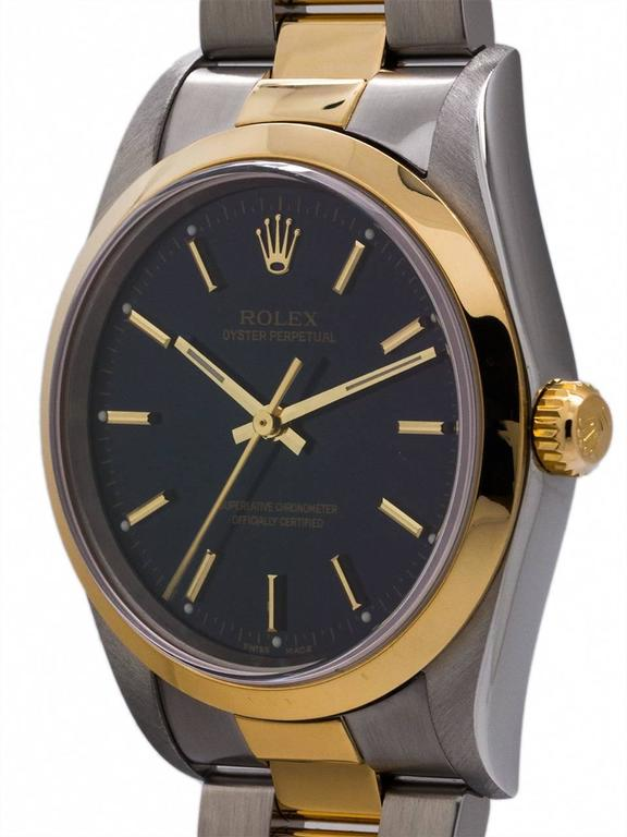Rolex Man's  SS/18K YG Oyster Perpetual ref# 14203 serial# D5 circa 2003. Featuring a 34mm case with smooth bezel, sapphire crystal, and  with original glossy blue dial with applied gold indexes and gilt baton hands. Featuring a man's size 34mm