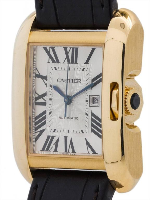 Cartier Tank Anglaise 18K YG man's automatic with date case model ref #3509 circa 2015. Featuring a beefy pillow shaped 30 X 39 mm case 9.5mm thick, with curved sapphire crystal, silvered dial with blued steel hands, and powered by Cartier caliber