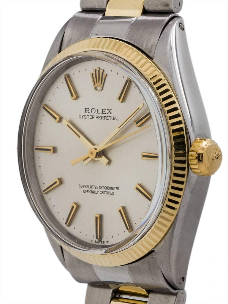 """Rolex Stainless Steel and 14K yellow gold Oyster Perpetual ref 1005 serial #2.2 million circa 1969. Featuring 34mm diameter case with fine engine turned """"milled"""" bezel and acrylic crystal. With original silver satin dial with applied gold indexes"""
