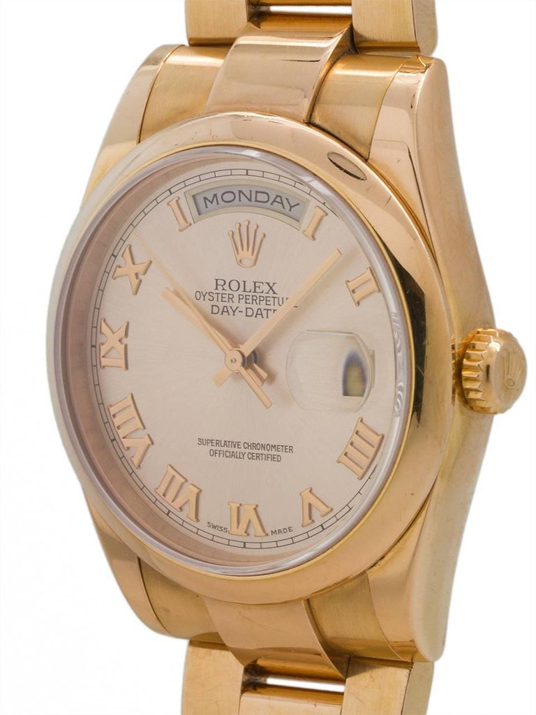 Rolex 18K PG Day Date President ref # 118235, serial# P8 circa 2000. 36mm full size man's model with popular sporty style configuration consisting of smooth domed bezel and Oyster Presidential bracelet with hidden clasp.  Featuring original and very