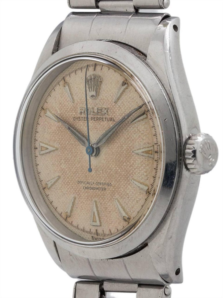 Vintage man's Rolex Oyster Perpetual ref #6284 in stainless steel circa 1950's. Featuring a 34mm diameter Oyster case in wonderful condition, with smooth dome bezel, acrylic crystal, and very pleasing original patina'd cream dial with raised  silver