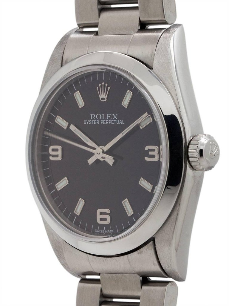 Rolex Oyster Perpetual midsize model ref 77080 stainless steel A2 serial # circa 1998. Featuring 31mm diameter case with smooth bezel and sapphire crystal and original black dial with popular 3/6/9 Explorer style configuration. Powered by self